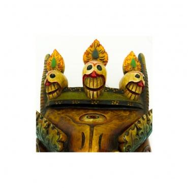 tête de mort sur dragon tibétain en bois