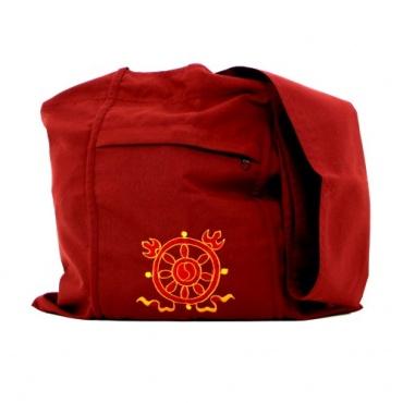 sac de moine bouddhiste rouge et roue du dharma
