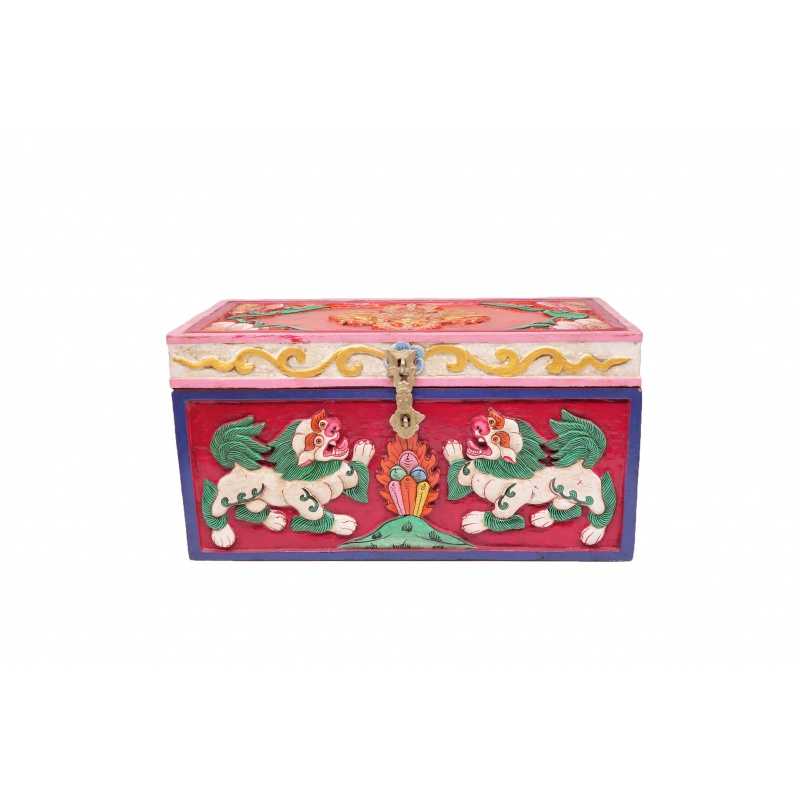 coffre tibétain et bois sculpté lion des neiges double vajra et lotus