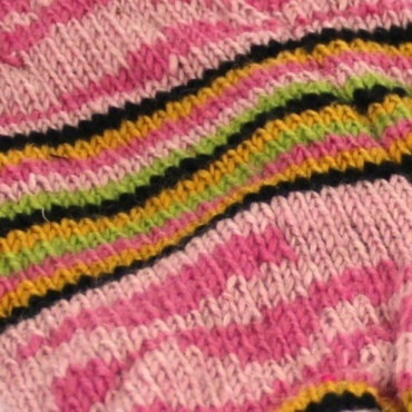 Jambières en laine rose tricotée main